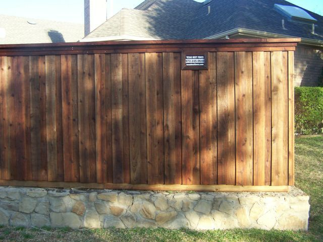 Board on Board Cedar Fence Stone Retaining Wall