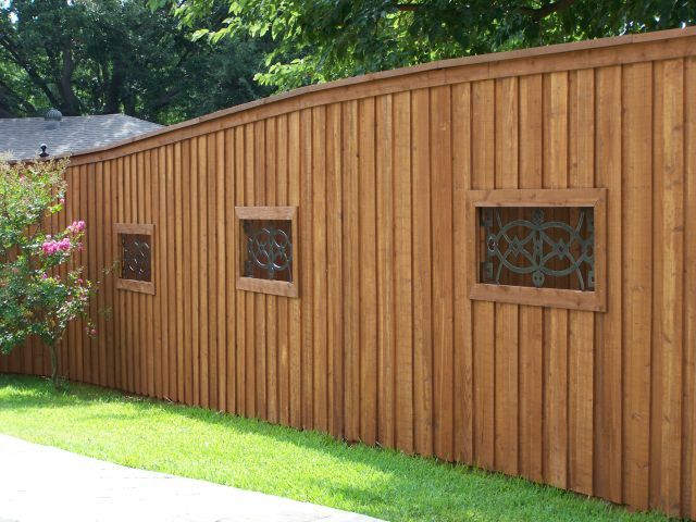 Board on Board Cedar Fence Wrought Iron Niches