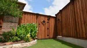 choosing the right fence - wood fence with garden gate