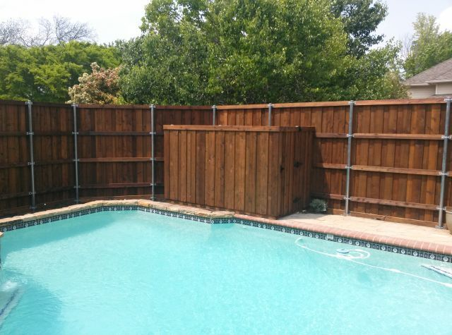 Rear View Pool Board on Board Fence Metal Posts