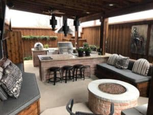 Outdoor features - outdoor living space with fire pit and outdoor kitchen