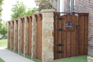 Outdoor features - wood fence with stone columns