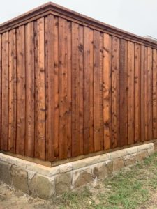fence maintenance - new stained wood fence