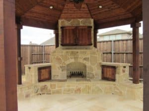 outdoor fire features - outdoor fireplace under patio cover