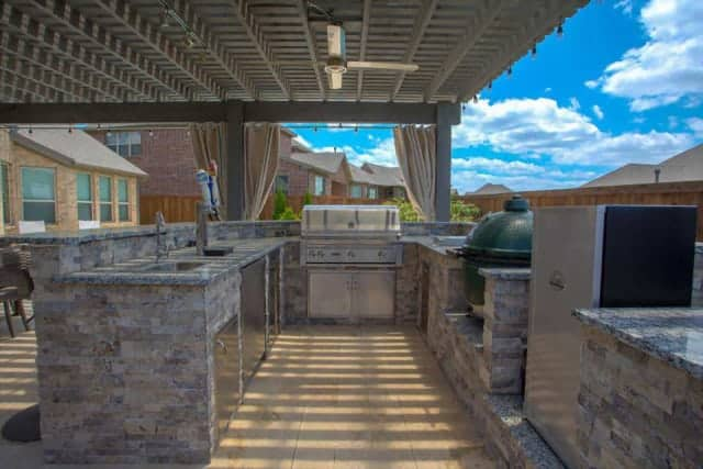 Outdoor Living - grey stone outdoor kitchen with stainless steel appliances under patio cover
