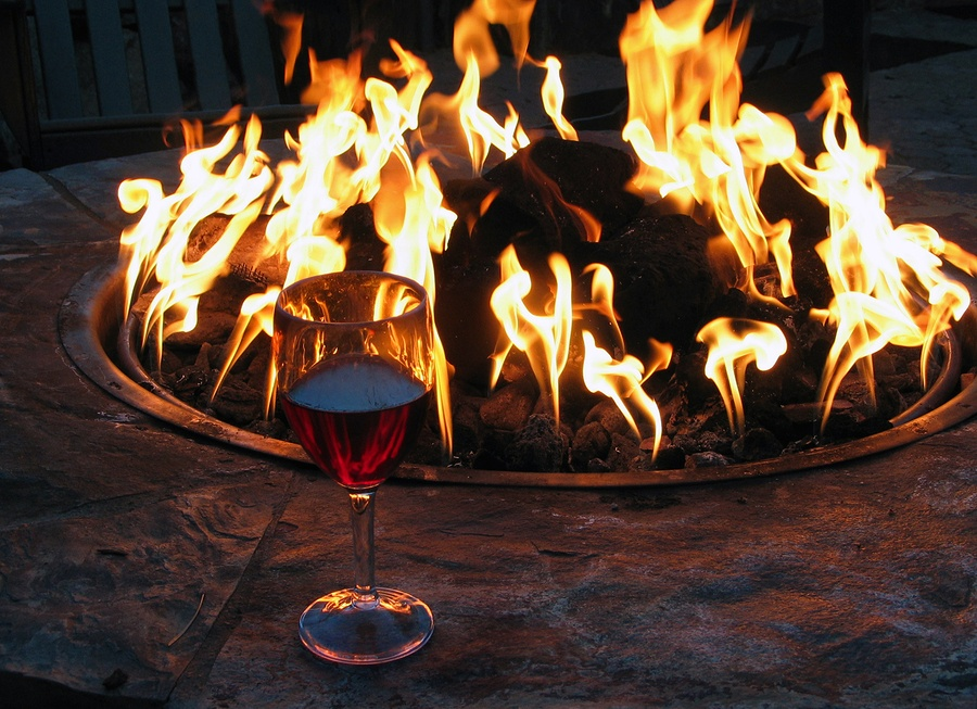 Fire pit maintenance - lit fire pit with wine glass