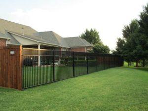 hardscape maintenance - wrought iron fence around backyard area