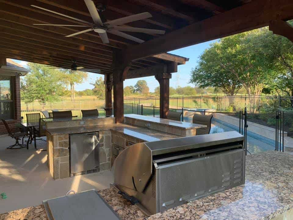 Outdoor Kitchen Space - outdoor kitchen with stainless steel appliances near swimming pool