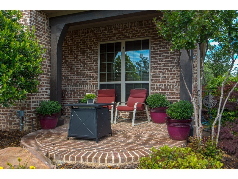 Outdoor Living - small brick patio area with seating and table