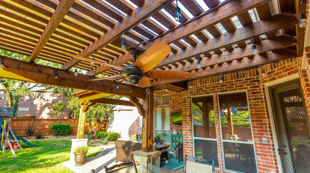 Game Day Space - Latticed wood patio cover with ceiling fan
