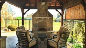 Outdoor Fire Features - Stone Fireplace Under Patio Cover