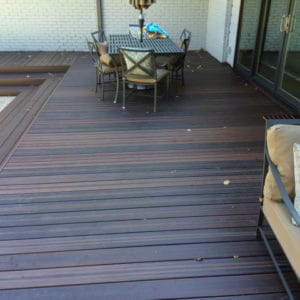 Composite Decking - dark brown composite deck with outdoor furniture