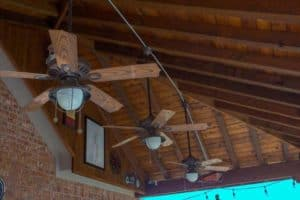 outdoor kitchen - ceiling fans with lights under patio cover