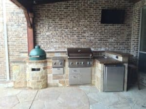 outdoor living kitchen - outdoor kitchen with stainless steel appliances and green egg smoker