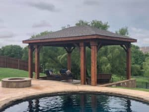 hardscape maintenance - detached patio cover near pool and fire pit