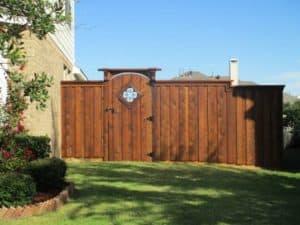hardscape maintenance - wood fence with wrought iron detailing