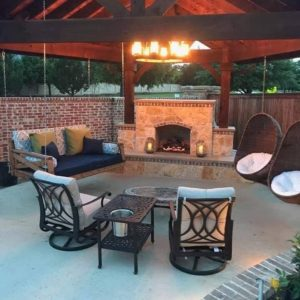 outdoor living for every season - outdoor living space under wood patio cover with outdoor fireplace
