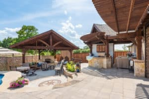 construction contractor - backyard oasis with patio covers and stonework