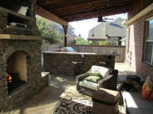 outdoor entertainment - outdoor living space with textiles and tv