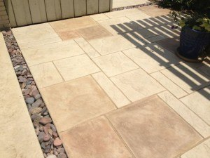 outdoor kitchen flooring - brushed stamped concrete floors in outdoor kitchen
