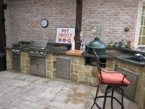 outdoor kitchen - outdoor kitchen space with grill and bar seating