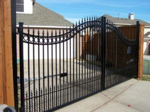 choosing the right fence - automatic wrought iron swing gate