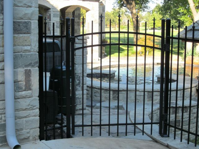 iron gate - wrought iron gate leading to pool area